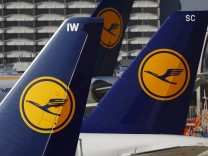 File picture shows planes of the Lufthansa airline standing on the tarmac in Frankfurt airport
