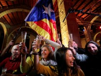 FILE PHOTO: People react to results in Catalonia's regional elections at a gathering of the Catalan National Assembly (ANC) in Barcelona