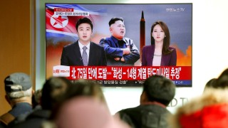 FILE PHOTO: People watch a TV broadcasting a news report on North Korea firing what appeared to be an intercontinental ballistic missile (ICBM) that landed close to Japan, in Seoul