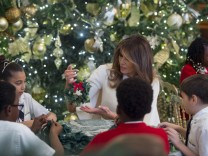 Melania Trump hosts military families to see White House Christmas decorations