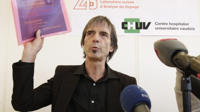 Director of the Swiss anti-doping laboratory Marcel Saugy holds papers of a presentation during a news conference in Lausanne