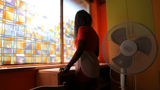 Nigerian ex-prostitute 'Beauty' (a pseudonym), poses in a social support centre for trafficked girls near Catania in Italy