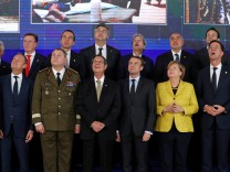 EU leaders take part in a group photo on the launching of PESCO
