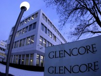 File photo of Swiss commodities trader Glencore's logo in front of its headquarters in Baar