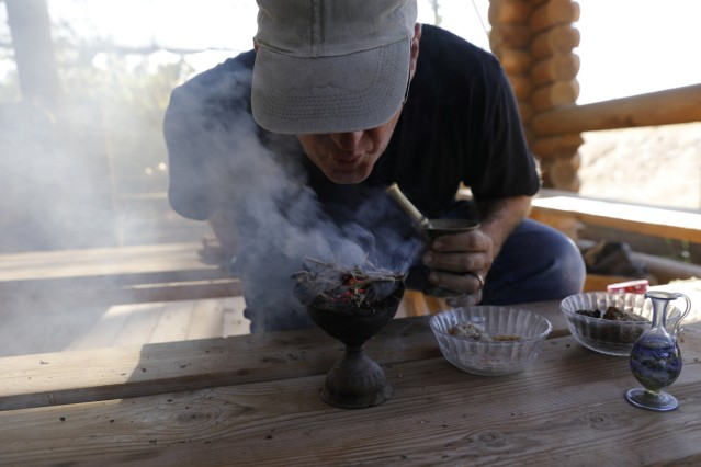 Guy Erlich, an Israeli entrepreneur, demonstrates the burning of dried and crushed resins of three plants, frankincense, myrrh and Balsam of Gilead in Kibbutz Almog, Judean desert, in the West Bank