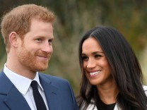 FILE PHOTO: Britain's Prince Harry poses with Meghan Markle in the Sunken Garden of Kensington Palace in London
