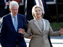 Democratic U.S. presidential nominee Hillary Clinton and her husband former U.S. president Bill Clinton depart after voting in the U.S. presidential election at the Grafflin Elementary School in Chappaqua