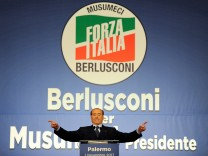Forza Italia party leader Silvio Berlusconi waves during a rally for the regional elections in Palermo