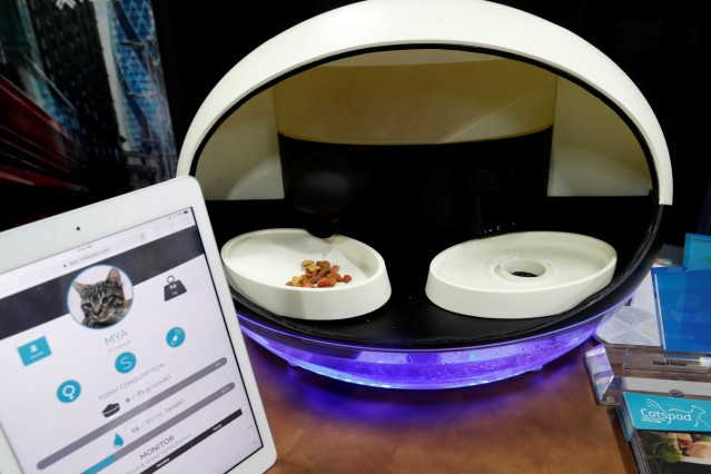 The Catspad smart pet assistant, with the ability to remotely schedule and control food portions, is displayed during CES Unveiled at the 2018 CES in Las Vegas