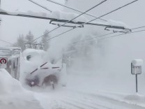 A train clears snow from a railway in Zermatt resort