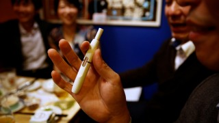 A man smokes iQOS at a restaurant in Tokyo
