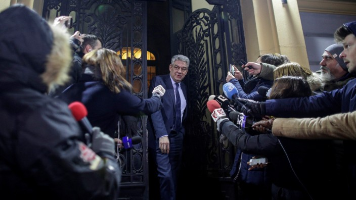 Romania's Prime Minister Tudose leaves a meeting of the Social Democrat Party in Bucharest