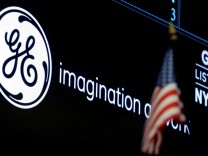 FILE PHOTO -The ticker and logo for General Electric Co. is displayed on a screen at the post where it is traded on the floor of the NYSE