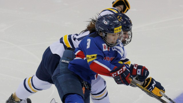 South Korea's Park and Quinnipiac University's Samoskevich reach for the puck during an Olympic preparation game for South Korea in Hamden