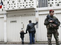 A French soldier secures the access to a Jewish school in Paris
