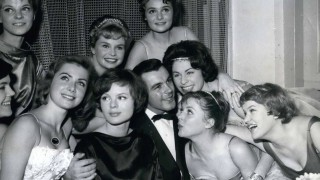 Jan 31 1959 Like a cock in the hen house pictured here is actor Toni Sailer at the Filmball 195