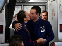 Crew members Paula Podest and Carlos Ciufffardi kiss after being married on board by Pope Francis during the flight between Santiago and the northern city of Iquique