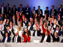Delegates vote during the SPD's party congress in Bonn