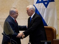 U.S. Vice President Mike Pence shakes hands with Israeli Prime Minister Benjamin Netanyahu ahead of his address to the Knesset, Israeli Parliament, in Jerusalem