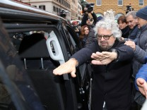 5-Star Movement member Beppe Grillo leaves after presenting the symbol of his party, that will run in the country's March 4 election, in Rome