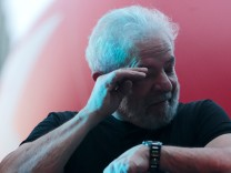 Brazil's former President Luis Inacio Lula da Silva reacts after his trial in Sao Paulo