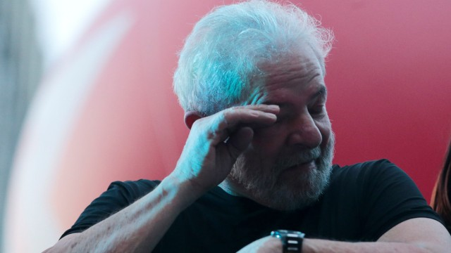 Brazil's former President Luis Inacio Lula da Silva reacts after his trial in Sao Paulo