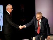 Czech presidential candidate Jiri Drahos and incumbent Milos Zeman shake hands after a televised debate ahead of an election run-off, in Prague