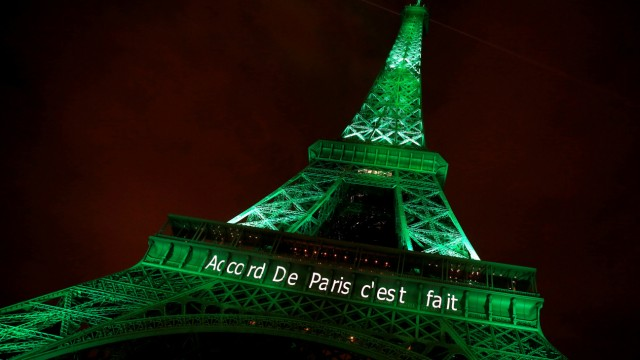 The Eiffel tower is illuminated in green with the words 'Paris Agreement is Done', to celebrate the Paris U.N. COP21 Climate Change agreement in Paris