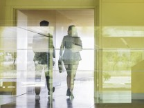 Business people walking in modern office corridor Business people walking in modern office corridor