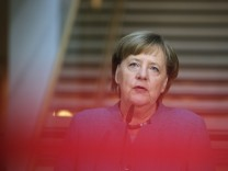 German Chancellor Merkel of the Christian Democratic Union (CDU) makes a statement before the coalition talks at the Social Democratic Party (SPD) headquarters in Berlin