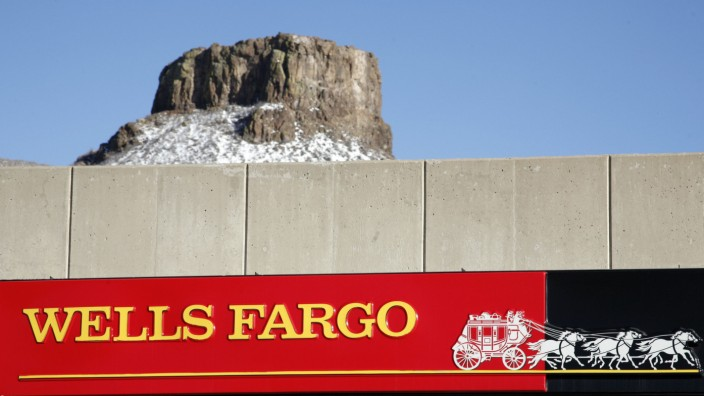 A Wells Fargo bank branch is framed by North Table Mountain in Golden