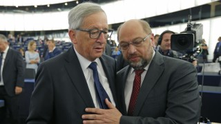 European Commission President Juncker talks with European Parliament President Schulz ahead of his address to the European Parliament in Strasbourg