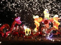 Folk artists perform a fire dragon dance under a shower of sparks from molten iron, ahead of the Chinese Lunar New Year, in Shangqiu
