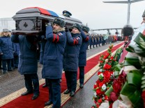 VORONEZH RUSSIA FEBRUARY 8 2018 Servicemen carry a coffin with the body of Russian pilot Roman