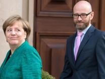 Tauber und Merkel