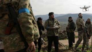 Turkish-backed Free Syrian Army fighters fly a drone in Northern Afrin countryside