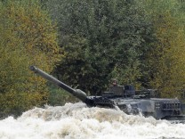 A Leopard 2 tank crosses a lake during a German army, the Bundeswehr, training and information day in Munster