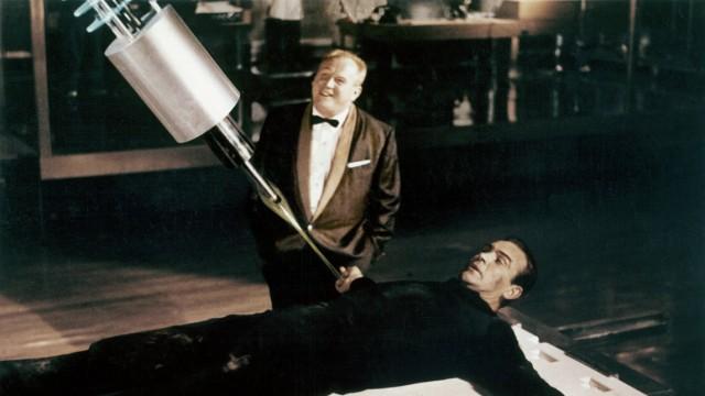 Studio Publicity Still Goldfinger Sean Connery Gert Frobe 1964 UA Hollywood CA USA PUBLICATIONxINx