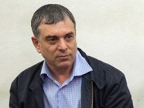 Shlomo Filber sits at the Magistrate Court during his remand in Tel Aviv