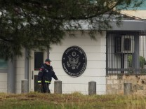 A policeman patrols in front of the United States embassy building in Podgorica