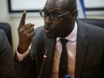 Haiti's Minister of Planning and External Cooperation Aviol Fleurant gestures during a news conference after a meeting with Oxfam's Ticehurst and Massot, in Port-au-Prince