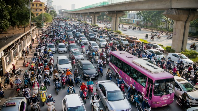 Vietnamese Motorists Battle Air Pollution In Fashion