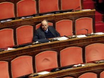 PdL party Senator Compagna seats alone at the Italian Senate in Rome