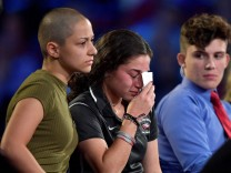 Marjory Stoneman Douglas High School student Emma Gonzalez comforts a classmate during a CNN town hall meeting, at the BB&T Center, in Sunrise