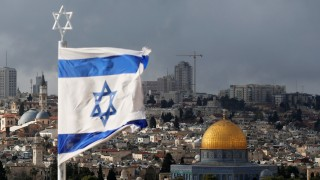 FILE PHOTO: An Israeli flag is seen near the Dome of the Rock, located in Jerusalem's Old City on the compound known to Muslims as Noble Sanctuary and to Jews as Temple Mount