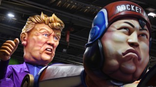 A float with giant figures of North Korean leader Kim Jong Un and U.S President Donald Trump is seen during preparations for the carnival parade in Nice