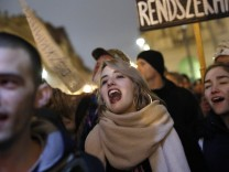 Protesters rally during a student-organizedanti-government demonstration in Budapest