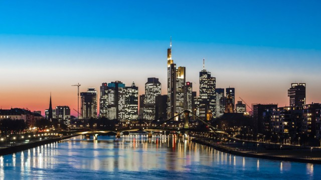 Germany Frankfurt view to skyline with Floesserbruecke and Main River in the foreground at twiligh