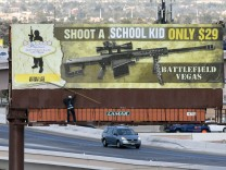 Subversive Art Group Vandalizes Billboard Ad For Battlefield Vegas Machine Gun Range