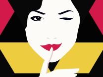 Zwinkernde Frau mit Finger auf den Lippen PUBLICATIONxINxGERxSUIxAUTxONLY Copyright xBaharx 2109001
